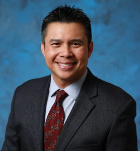 Board Member Dr. Larry Natividad